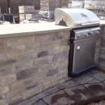 stone wall with grill and bar