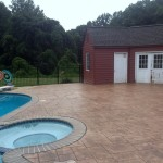 a stamped concrete pool deck