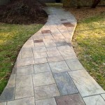 Multi-color stained stamped concrete walkway