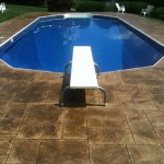 stamped concrete pool deck and diving board