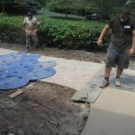 concrete contractors installing a walkway