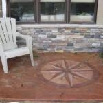 acid stain patio with custom design