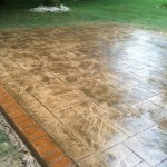 stamped concrete patio with brick border