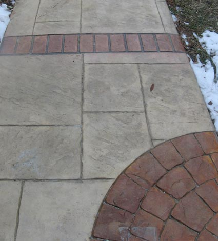 stamped concrete walkway with brick pattern